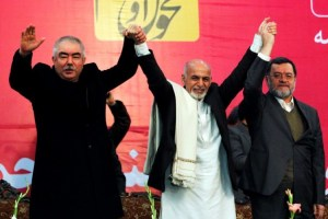 Afghan presidential candidate Ashraf Ghani Ahmadzai (C) and his two vice-presidential candidates Abdul Rashid Dostum (L), a former Uzbek militia leader, and Sarwar Danish (R) attend the first day of the presidential campaign in Kabul, February 2, 2014. Credit: Reuters/Omar Sobhani