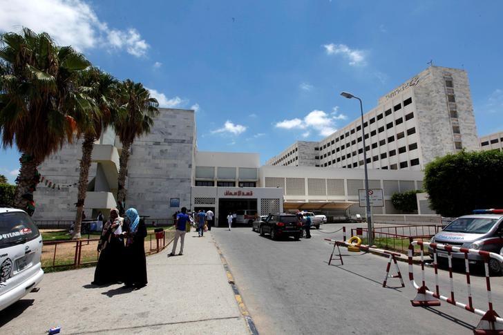 Libyans walk at Tripoli Medical Center in Tripoli, Libya, July 20, 2016. Picture taken July 20, 2016. REUTERS/Ismail Zitouny