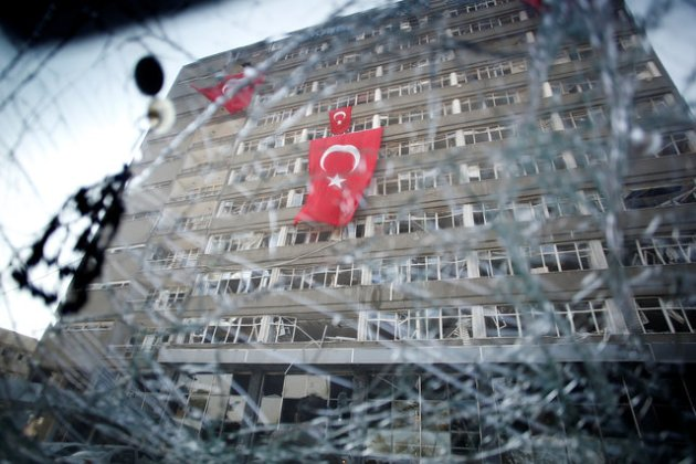 The Ankara police headquarters is seen through a car's broken window caused by fighting during a coup attempt in Ankara, Turkey, July 19, 2016. REUTERS/Baz Ratner