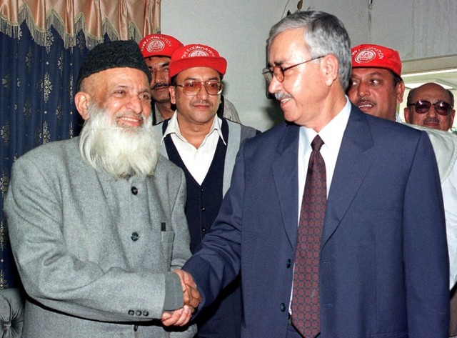 Rehmatullah Mosa Ghazi, Charge d'Affaires at the Afghanistan Embassy (R), greets Abdul Sattar Edhi, Pakistan social worker, at the Afghan embassy in Islamabad, Pakistan, March 27, 2002. REUTERS/Faisal Mahmood/File Photo