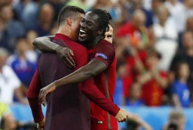 Portugal's Cristiano Ronaldo and Eder celebrate after winning Euro 2016. Credit: REUTERS/Kai Pfaffenbach