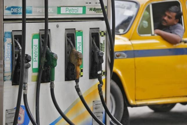 A driver waits in a taxi for his turn to fill up his tank with diesel at a fuel station. Credit: Reuters/Rupak De Chowdhuri/Files