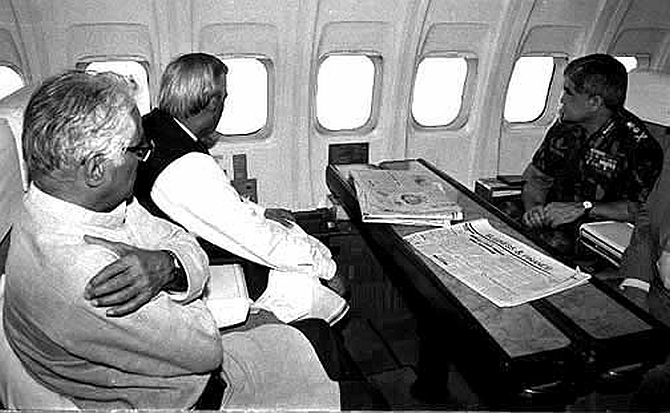 In this file photograph from 1999, defence minister George Fernandes, Prime Minister Atal Bihari Vajpayee and army chief General V.P. Malik survey the battlezone from above. Credit: PIB