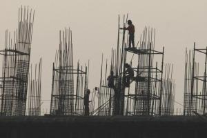 Labourers work at the site of a commercial building under construction in Noida. Credit: Reuters/Anindito Mukherjee/Files