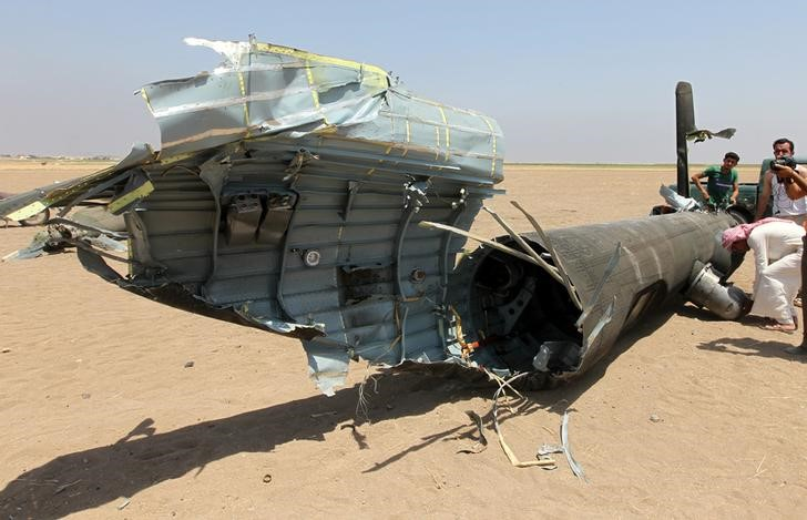 Men inspect the wreckage of a Russian helicopter that had been shot down in the north of Syria's rebel-held Idlib province, Syria August 1, 2016. Credit:REUTERS/Ammar Abdullah
