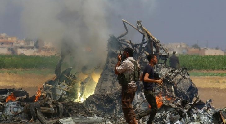 Men inspect the wreckage of a Russian helicopter that had been shot down in the north of Syria's rebel-held Idlib province, Syria August 1, 2016. Credit: Reuters/Ammar Abdullah