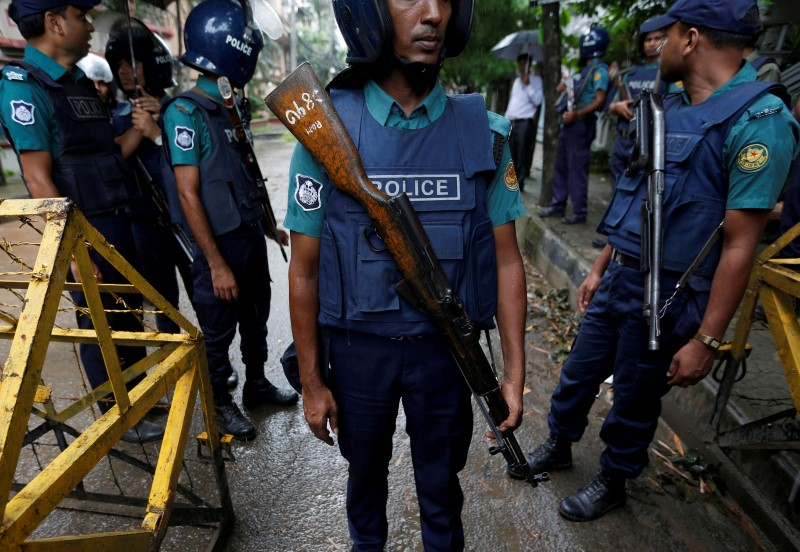 Policemen stand guard along a road leading to the Holey Artisan Bakery and the O'Kitchen Restaurant after gunmen attacked, in Dhaka, Bangladesh, July 3, 2016. Credit: REUTERS/Adnan Abidi/File Photo