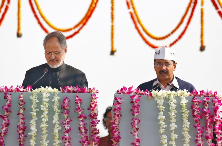 File photo of Delhi lieutenant general Najeeb Jung swearing in Arvind Kejriwal as chief minister of Delhi. Credit: Reuters