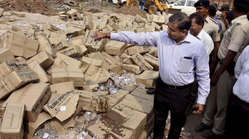 File photo of liquor bottles being destroyed in Bihar. Credit: PTI