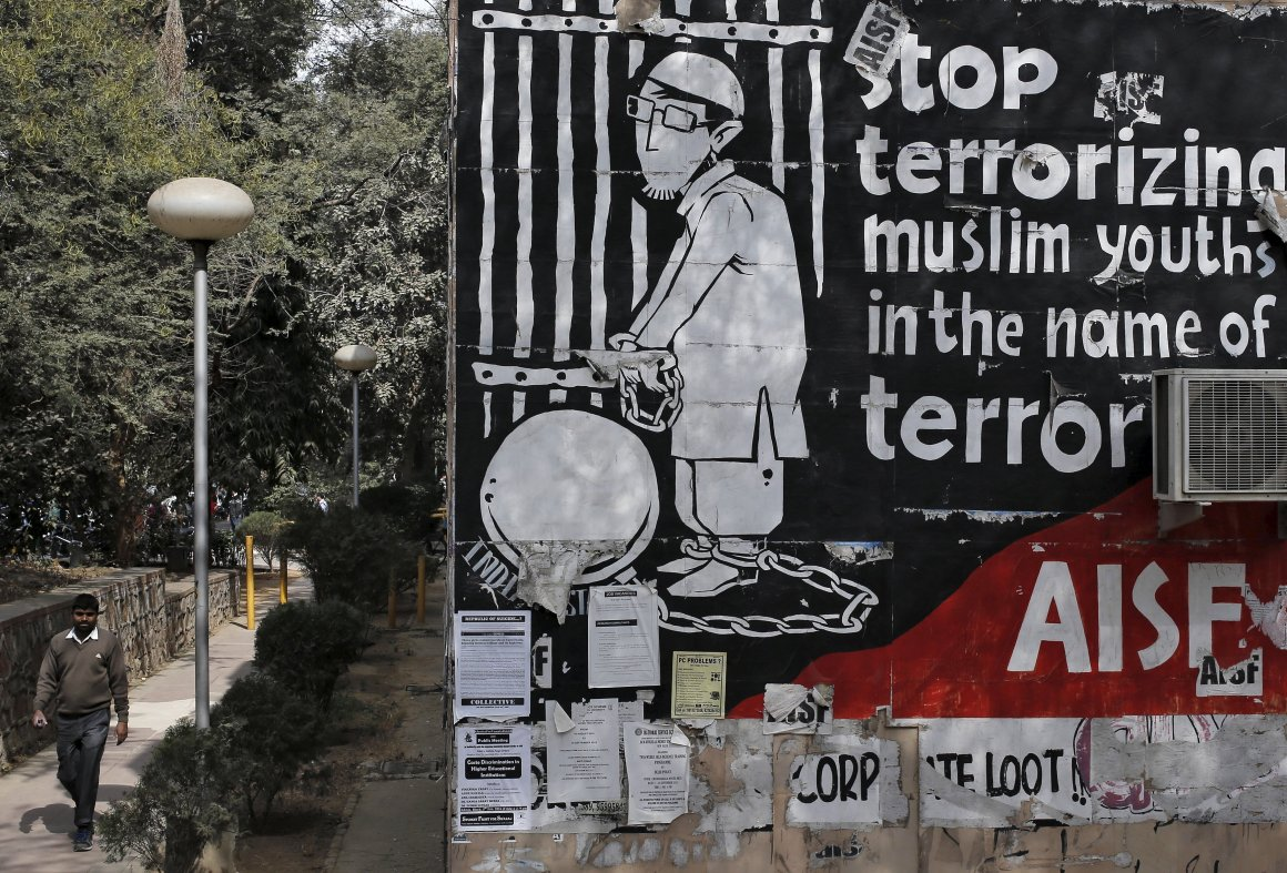 A man walks past graffiti inside the Jawaharlal Nehru University (JNU) campus in New Delhi. Credit: Anindito Mukherjee/Reuters