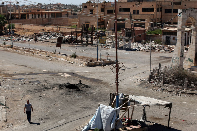 A man walks near a hole in the ground after an airstrike on Sunday in the rebel-held town of Dael, in Deraa Governorate, Syria September 19, 2016. REUTERS/Alaa Al-Faqir