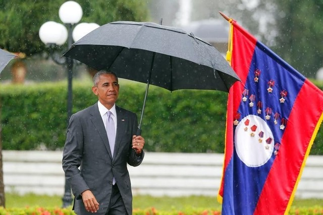 US President Barack Obama walks to honour guard during a welcoming ceremony at the Presidential Palace in Vientiane, Laos September 6, 2016. Credit: Reuters/Jorge Silva