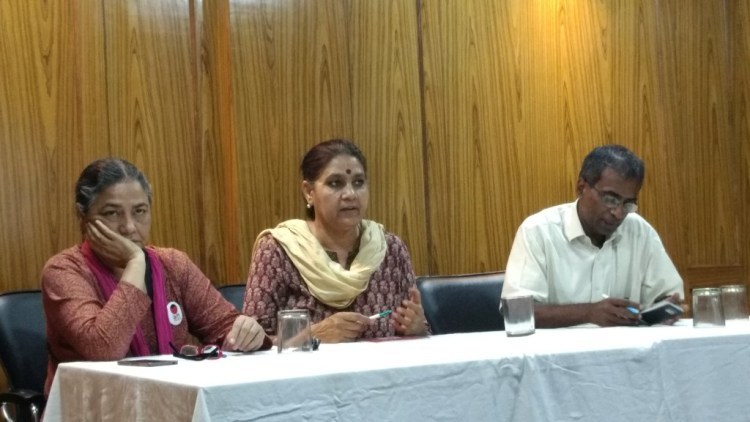 Sejho Singh(left), Jagmati Sangwan (centre) and Sabu George (right) address the press conference.