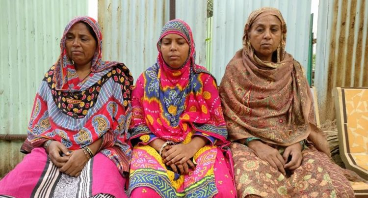 Family members of Ayyub, (Left to right) Mehraj banu (mother), Afsana (sister), Khehrunisa (aunty) waiting outside the postmortem room at VS Hospital, Ahmedabad on September 17. Credit: Damayantee Dhar