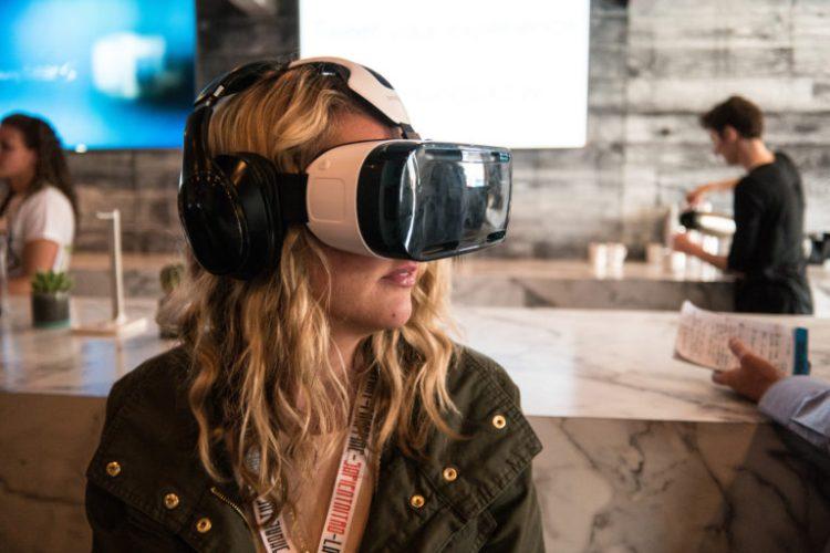 Woman using a virtual reality headset. Credit: Nan Palmero/Flickr, CC BY 2.0
