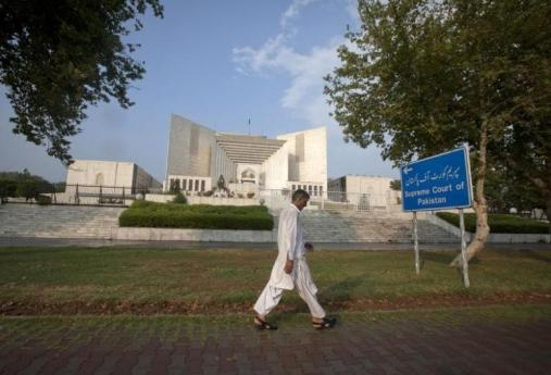 A man walks past the Supreme Court building in Islamabad. Credit: Reuters/Faisal Mahmood/Files
