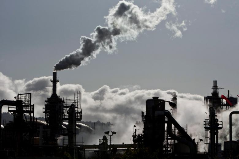 Smoke is released into the sky at a refinery in Wilmington, California March 24, 2012. REUTERS/Bret Hartman