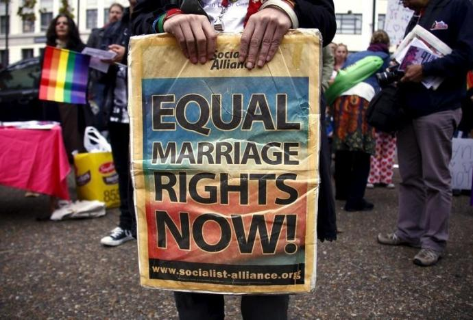 A gay rights activist holds a placard during a rally supporting same-sex marriage, in Sydney, Australia May 31, 2015. REUTERS/David Gray