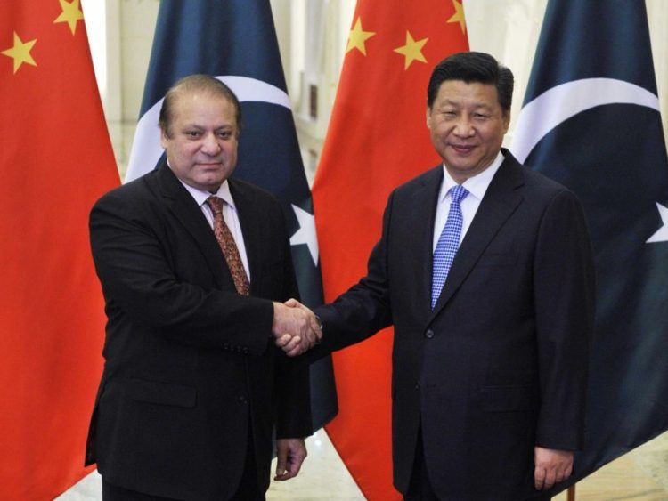 Pakistan's Prime Minister Nawaz Sharif shakes hands with China's President Xi Jinping. Credit: Reuters