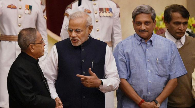 President Pranab Mukherjee (L) with Prime Minister Narendra Modi (C) and Defence Minister Manohar Parikkar (R). Credit: PTI/Files