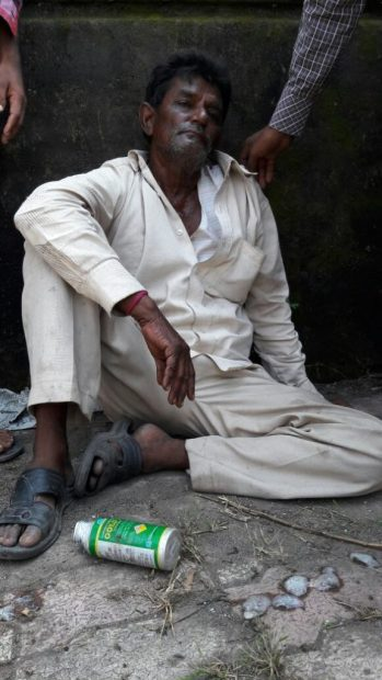 Prabhatbhai, still sitting in protest after consuming pesticide while people convince him to get treated. Credit: Damayantee Dhar