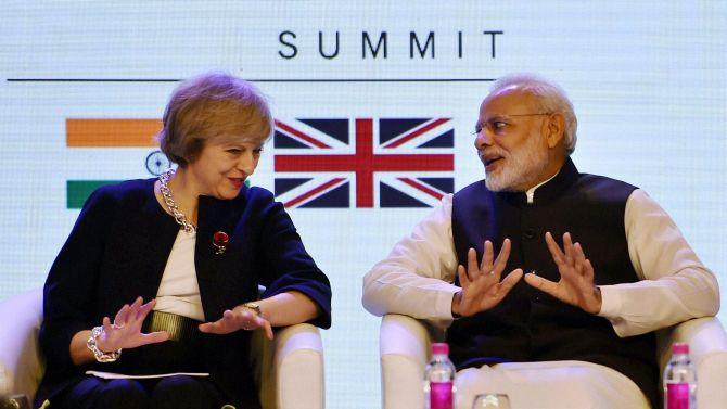 Prime Minister Narendra Modi with his UK counterpart Theresa May at the inauguration of India-UK Tech Summit in New Delhi on Monday. Photograph: Vijay Verma/PTI
