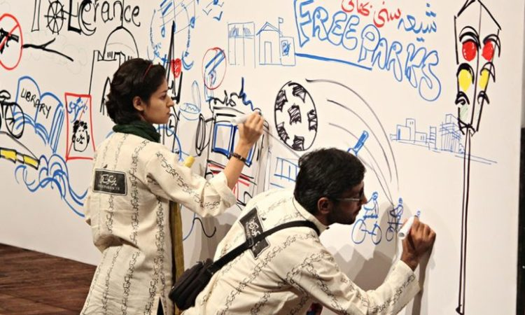 Interactive mural being made with the help of the audience at Pursukoon Karachi 2013 Credit: Dawn