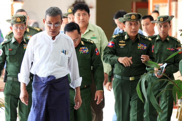 Rakhine Chief Minister Nyi Pu (L) and Myanmar's high ranking military officers walk after a day trip with a diplomatic mission and United Nations officials to the Maungdaw areas in northern Rakhine State in Myanmar November 3, 2016. Credit: Reuters/Wa Lone