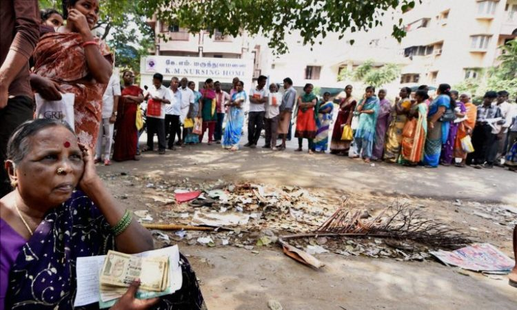 People standing in queue to exchange their old notes at a bank in Chennai. Credit: PTI