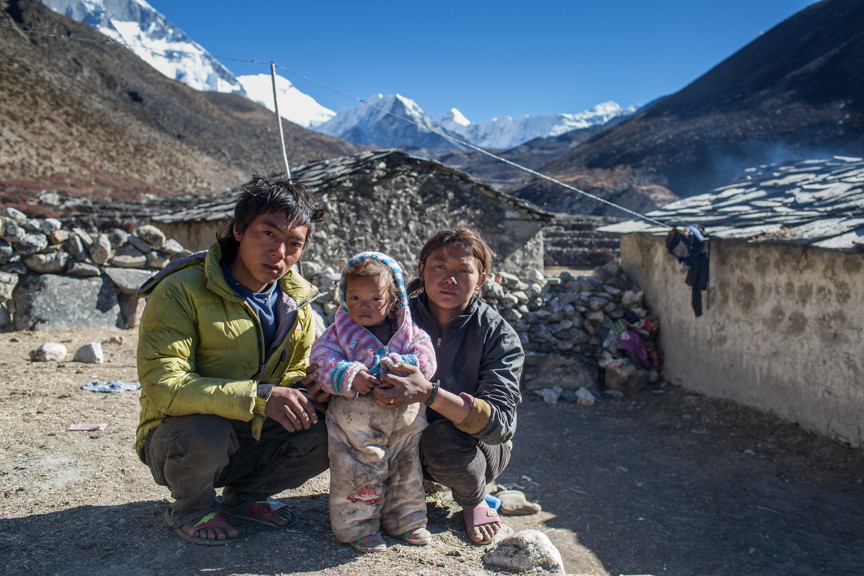 "Ajit Rai and his wife Ranjita Rai works as labourer in Dengboche Village, the way to Imja Glacier and Everest Base Camp. Ajit Says, "" Last year a small flash flood tiggred from other glaicial lake that mixed with imja river, althrough ,it only destroyed one bridge near Dengboche, it has made me to think more about safety of my family"". Solukhumbu District, Nepal. Credit: Nabin Baral"