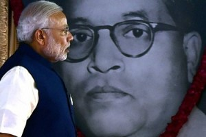 Prime Minister Narendra Modi walks past an image of Ambedkar. Credit: PTI