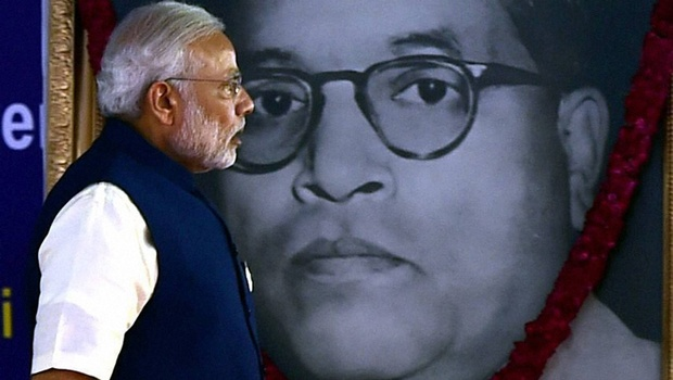 Prime Minister Narendra Modi walks past an image of Ambedkar. Credit: PTI
