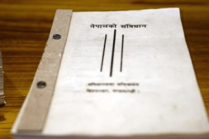 A copy of Nepalese constitution lies on the table inside the parliament in Kathmandu, Nepal September 18, 2015. Credit: Reuters/Navesh Chitrakar/Files
