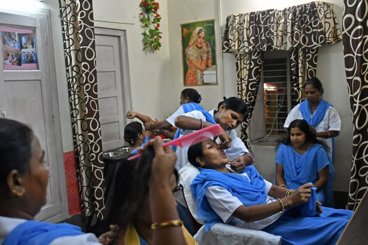 Rehabilitated manual scavengers learn and practice beauty treatment techniques inside a rehabilitation center called Nai Disha run by an NGO , in Alwar, Rajasthan, India on 23 September 2016.