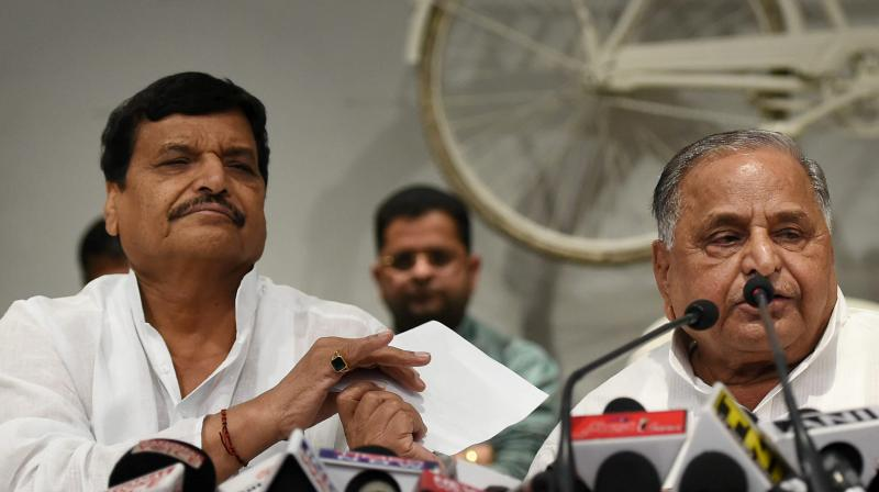 File photo of Shivpal Yadav (left) and samajwadi Party supremo Mulayam Singh Yadav. Credit: PTI