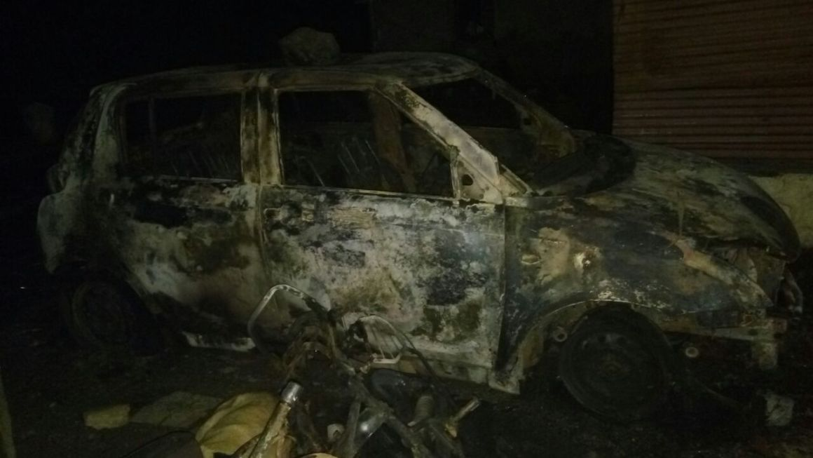 A vehicle burnt in the mob attack on Panchashil Nagar. Credit: Kirtikumar Shinde
