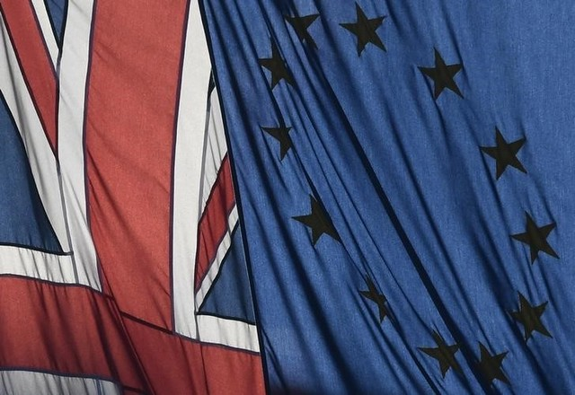 A Union flag flies next to the flag of the European Union in London, Britain, January 24, 2017.  REUTERS/Toby Melville/Files