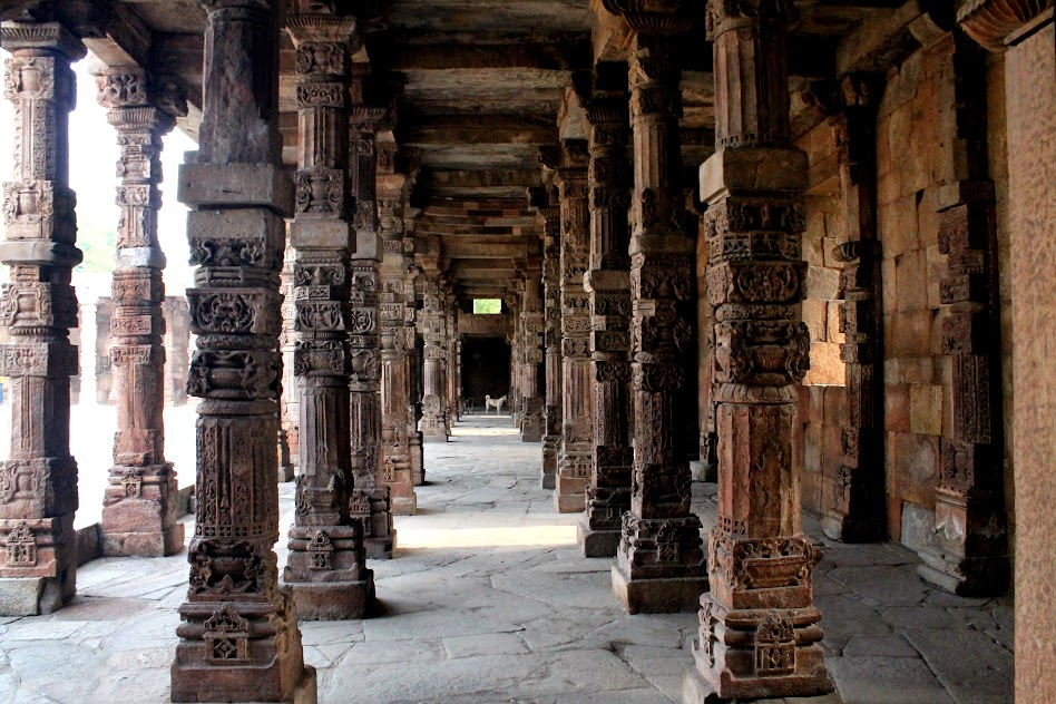 Pillars from former Hindu and Jain temples which were re-used in the Qutb Mosque. The arrangement forms a good example of the pillar and beam construction.