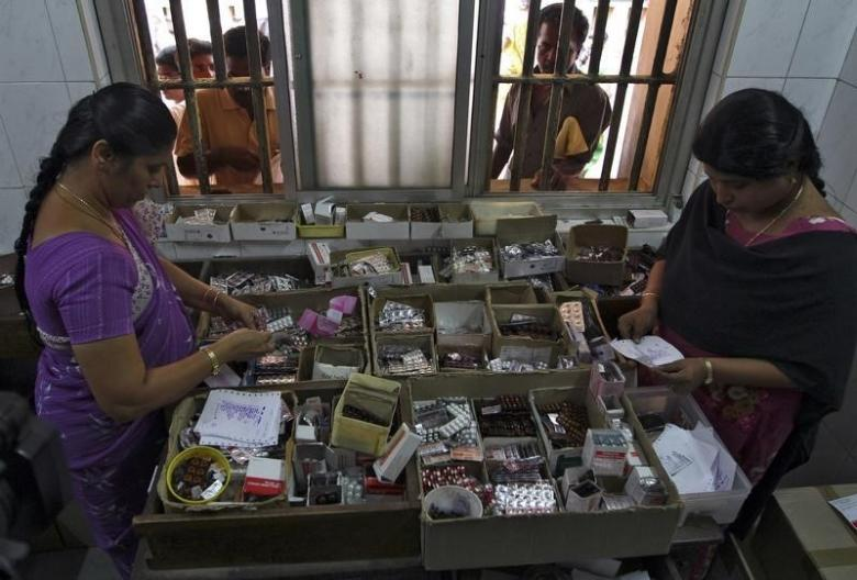 Pharmacists dispense free medication, provided by the government, to patients at Rajiv Gandhi Government General Hospital in Chennai July 12, 2012. Credit: Reuters/Babu/Files