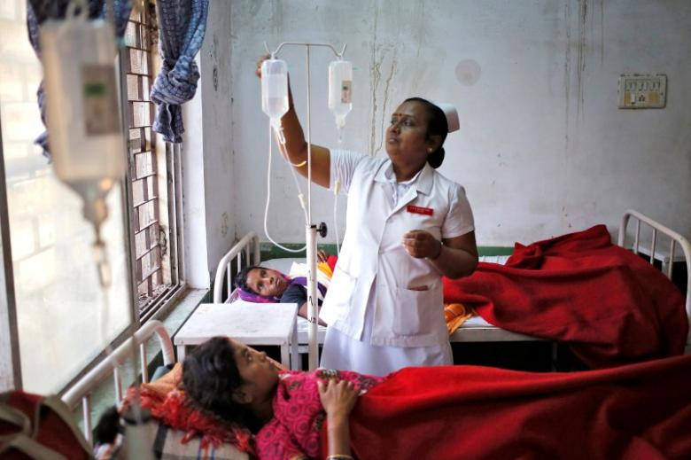 "A nurse tends to a woman, who underwent a sterilization surgery at a government mass sterilisation ""camp"", at Chhattisgarh Institute of Medical Sciences (CIMS) hospital in Bilaspur, in the eastern Indian state of Chhattisgarh, November 13, 2014. Credit: Anindito Mukherjee/Reuters/Files"