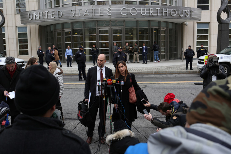 Guzman's defense attorneys outside the federal courthouse where he will be tried. Credit: Joe Penney/Reuters