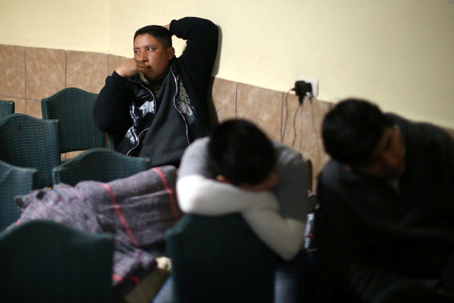 Migrants sit in the chapel at the Juan Bosco migrant shelter after being deported from the US., in Nogales, Sonora, Mexico, February 1, 2017. Picture taken February 1, 2017. Credit: Reuters