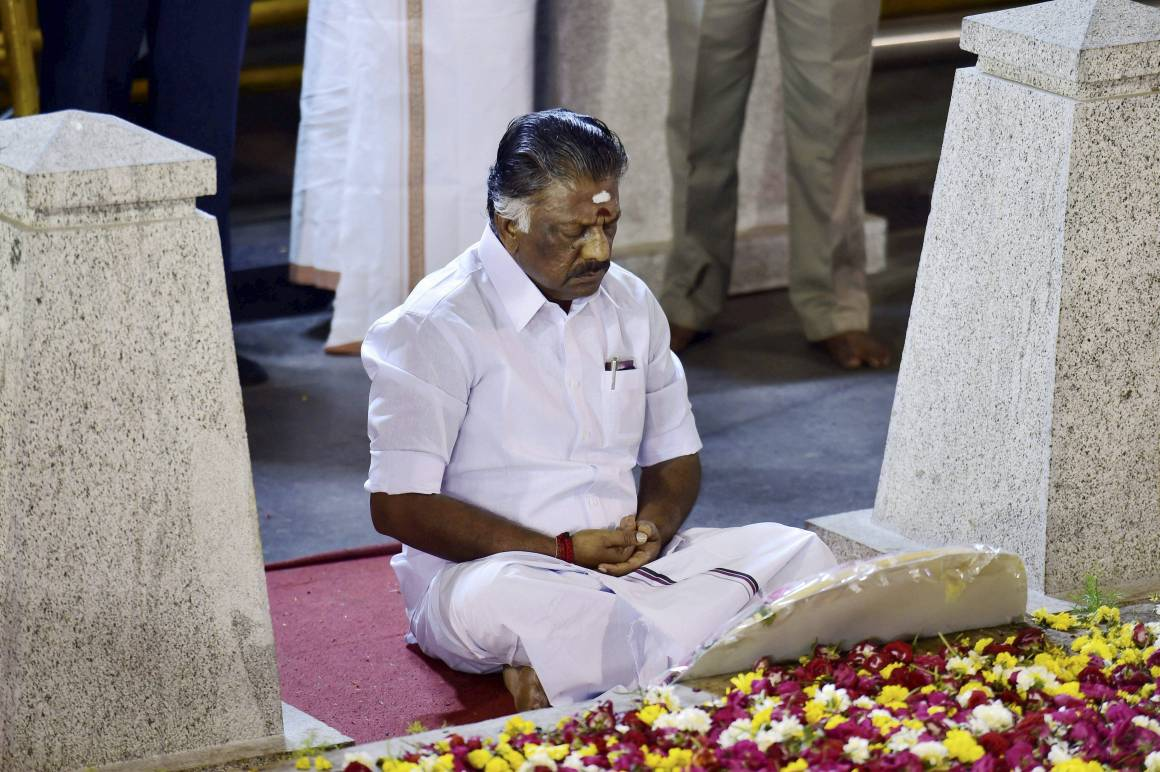 Tamil Nadu Chief Minister O. Panneerselvam sitting in meditation in front of the late J. Jayalalithaa's burial site at Marina Beach in Chennai on Tuesday. On Sunday, he tendered his resignation from the post paving the way for AIADMK general secretary V.K. Sasikala to become chief minister. Credit: PTI/R. Senthil Kumar(PTI2_7_2017_000260B)
