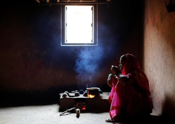 Kamal Keshavtupange, 60, who studies at Aajibaichi Shaala (Grandmothers' School), drinks tea inside her house in Fangane village, India, February 15, 2017. Credit: Danish Siddiqui/Reuters