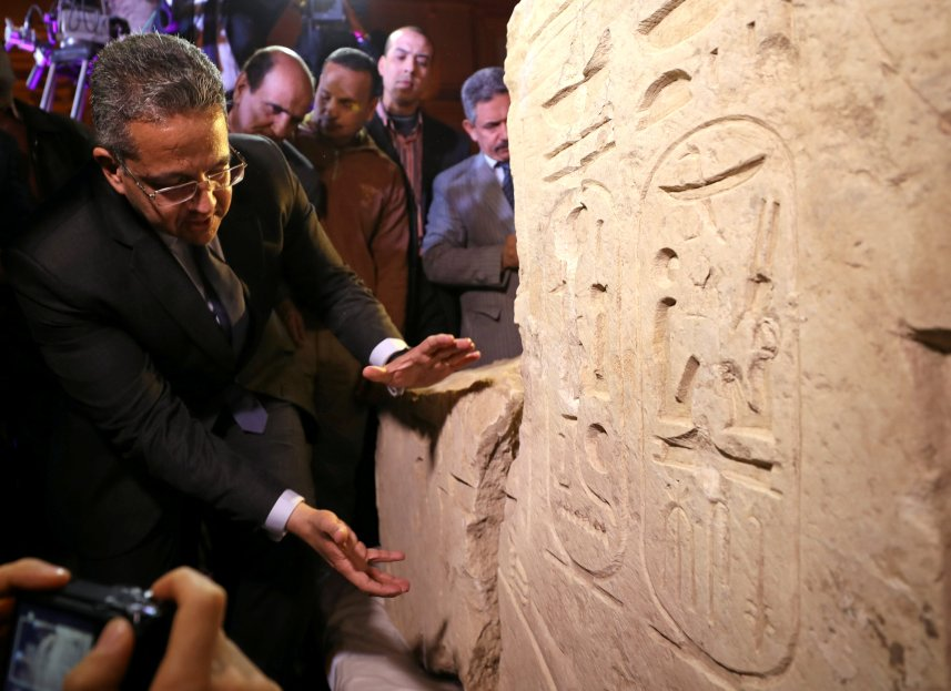 Egyptian Minister of Antiquities Khaled Al-Anani stands beside the collosus explaining new evidence pointing to it depicting Psammetich I in Cairo, Egypt, March 16, 2017. Credit: Mohamed Abd El Ghany/Reuters