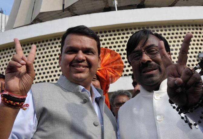 Maharashtra state finance minister Sudhir Mungantiwar (right). Credit: PTI