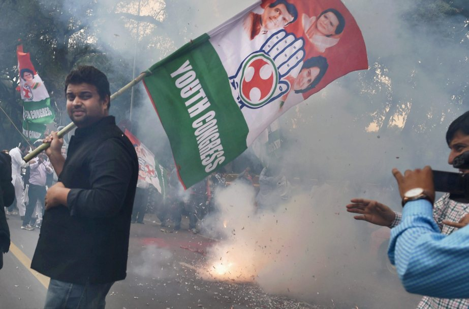New Delhi: Youth congress activists celebrate party's thumping win in Punjab state Assembly elections, at AICC in New Delhi on Saturday. PTI Photo by Vijay Verma(PTI3_11_2017_000122B)