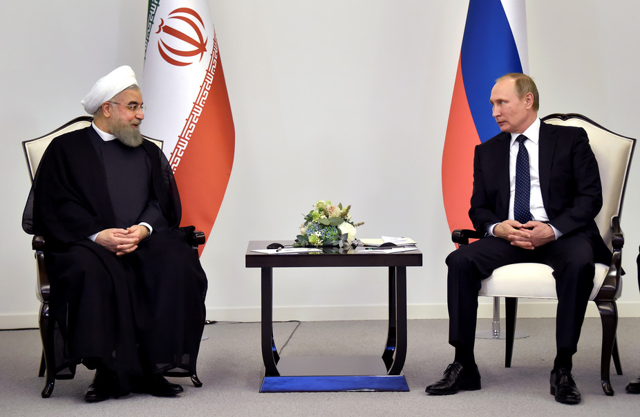 Iranian President Hassan Rouhani talks to Russian President Vladimir Putin during a meeting in Baku, Azerbaijan on August 8 2016. Credit: Reuters