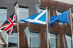 The Union Flag, The Saltire and the European flag fly outside the Scottish Parliament in Holyrood Edinburgh, Scotland March 13, 2017. Credit: Reuters/Russell Cheyne