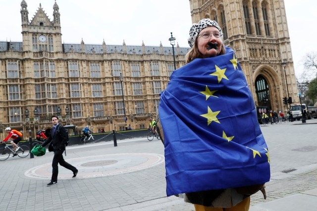 An anti-Brexit protester stands outside the houses parliament on the day Prime Minister Theresa May will announce that she has triggered the process by which UK will leave the EU, in London, March 29, 2017. Credit: Reuters